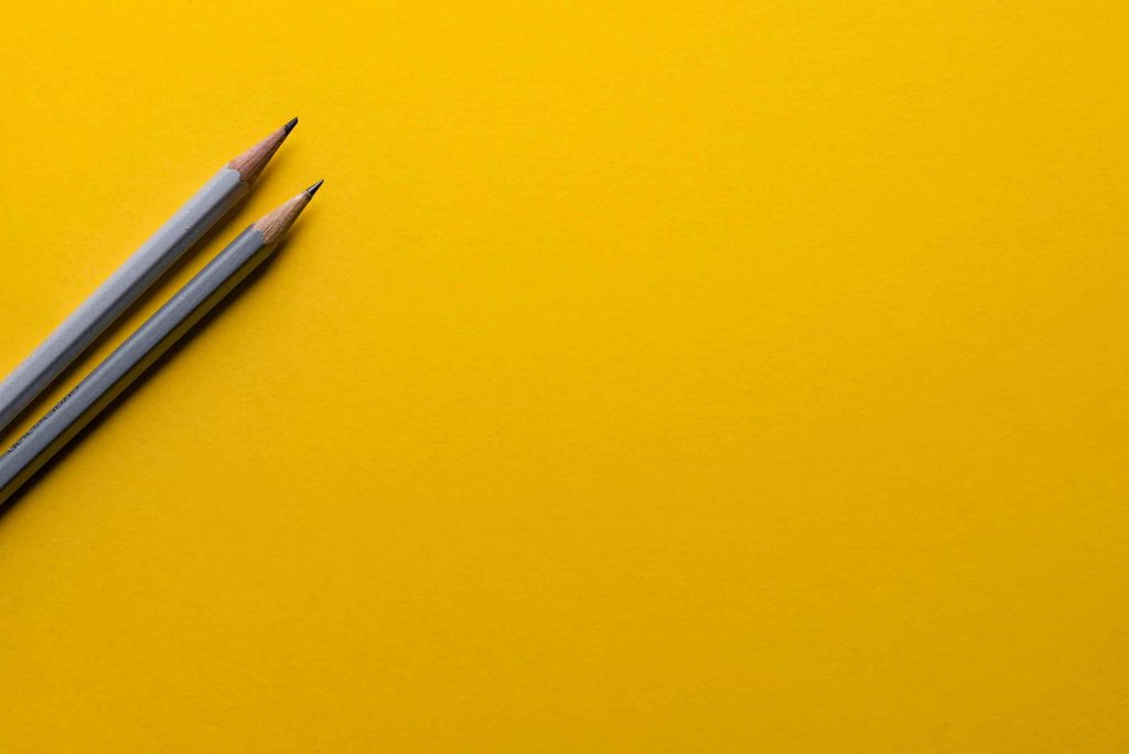 pen on yellow background